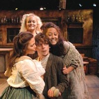 When Irish guys are smiling (from left): Rebecca Berkman-Rivera, Amanda Jane Cooper and Laura Lee Mixon welcome Jerzy Gwiazdowski, playing the title character in PICT's <I>The Playboy of the Western World</I>.