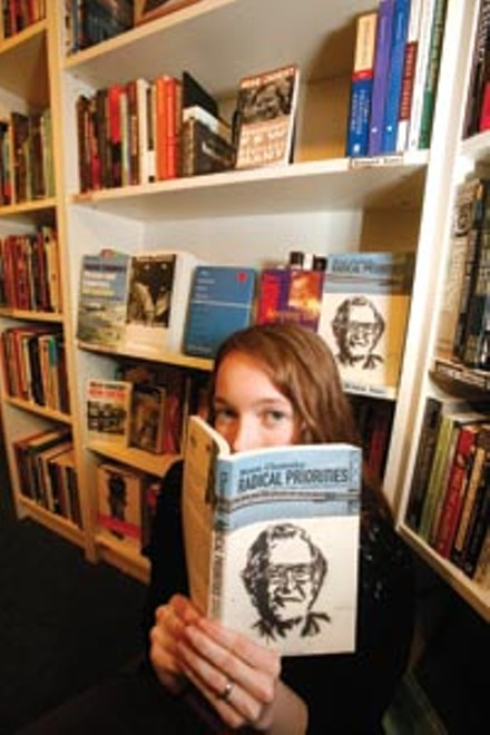 Word up: Pam Wilson, a Big Idea Collective member for five years, mans the bookstore's Chomsky collection. - HEATHER MULL