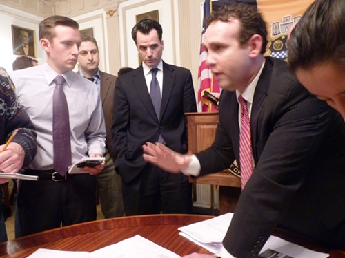 Yarone Zober goes over debit card expenses with members of the media Friday, while City Solicitor Dan Regan close at hand