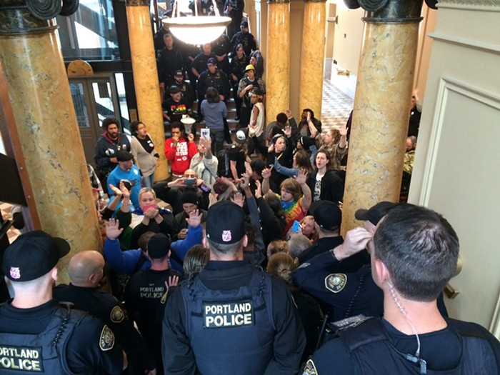 Protestors chant in Portland City Hall, as police block off access to the third floor, where City Council met in a closed-off session.