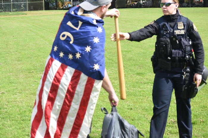 A police officer taking his bat