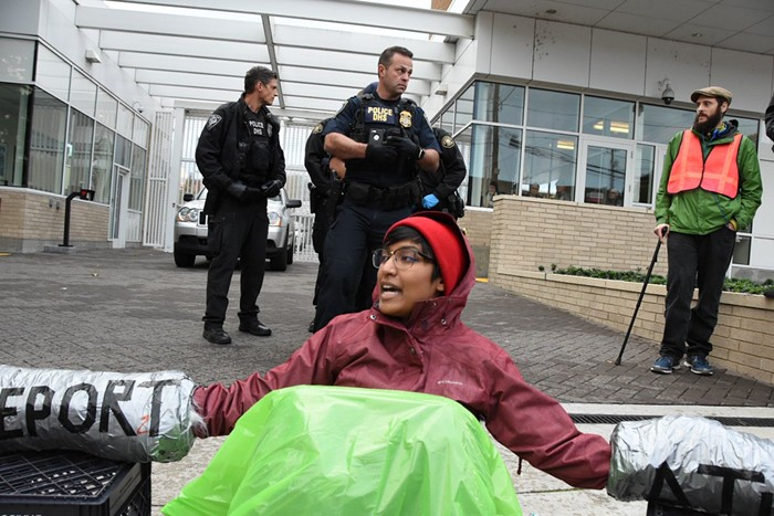 One of five members of a human chain in front of the ICE facility in Southwest Portland.