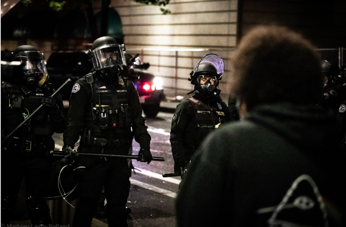 Portland police face a line of protesters during June demonstrations.
