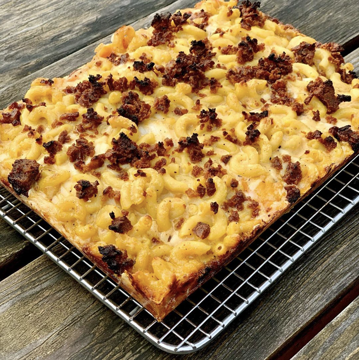 Believe it or not, this Detroit-style bacon mac and cheese pizza from Boxcar Pizza is 100% vegan.