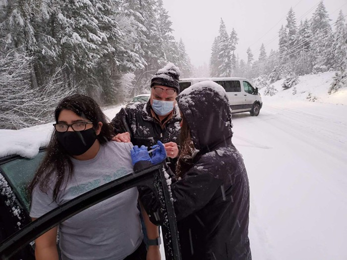 Stranded on a snowy highway, six Oregonians got surprise COVID-19 vaccines last night.