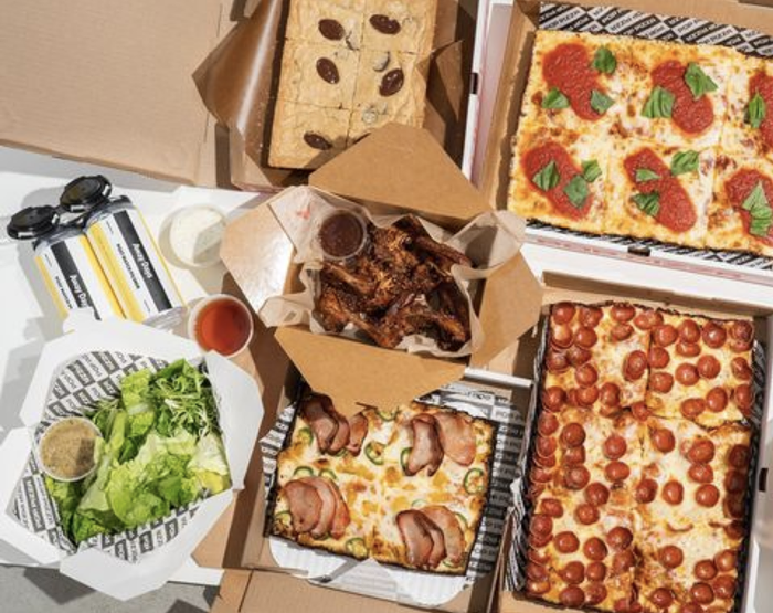 Pop Pizzas deluxe Super Bowl combos include Detroit-style pizza, salads, cookie squares, and optional wings from Hat Yaiand beer from Away Days Brewing Co.