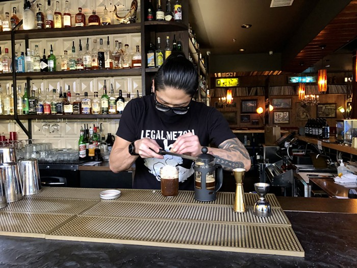 Keys Lounge bar manager Joel Lee puts the finishing touches on a coffee cocktail.