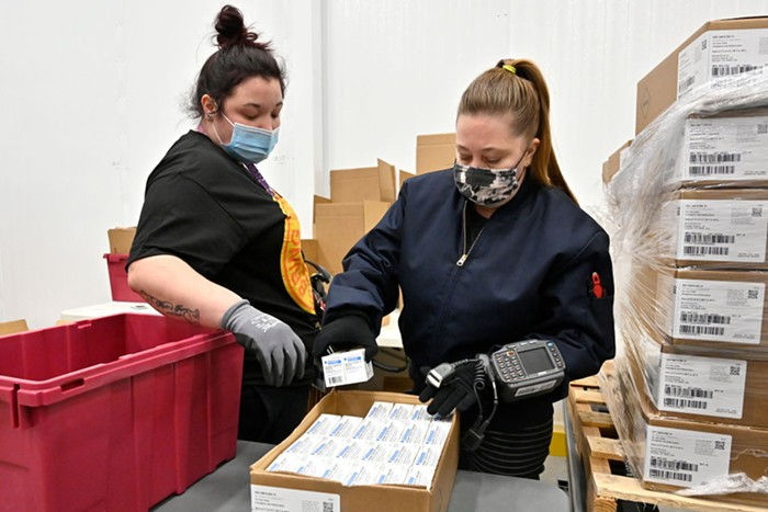 An employee with the McKesson Corporation scans a box of the Johnson and Johnson COVID vaccine as she fills an order at their shipping facility on March 1, 2021 in Shepherdsville, Kentucky.