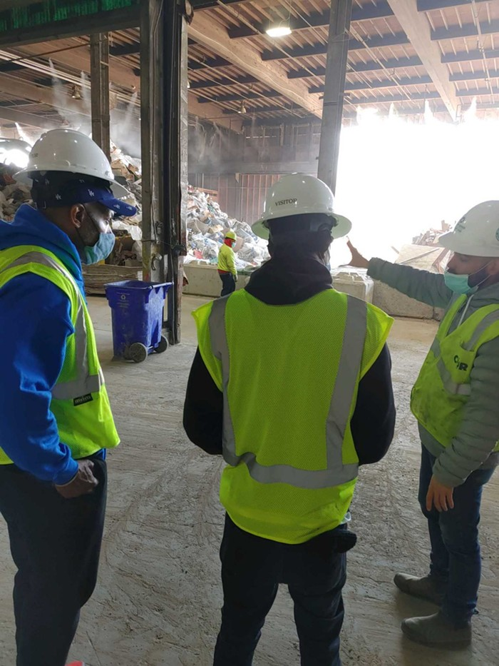 Mike Bretto Jackson and a man he mentors on a recent job orientation tour of at the City of Roses Disposal & Recycling Center
