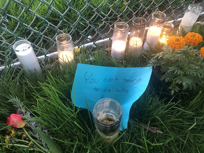 Candles, notes, and flowers make up a memorial for Robert Delgado, the man killed by Portland police Friday, in Lents Park.