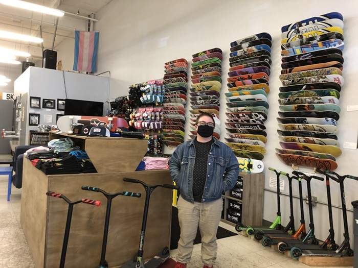 Waters standing in the merchandise section of Stronger Skatepark.