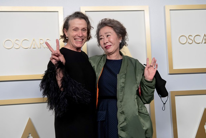 Frances McDormand (winner of Best Actress, Nomadland) and Yuh-Jung Youn (winner of best supporting actress, Minari)post at the 93rd Annual Academy Awards at Union Station on April 25, 2021 in Los Angeles, California.