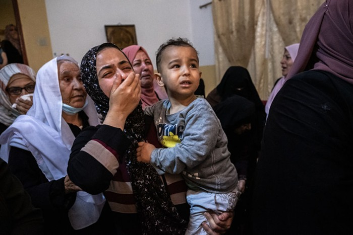 Relatives of Palestinian Ahmed Al-Shenbari, who was killed during an Israeli raid in Beit Hanoun city on the northern Gaza Strip, mourn during his funeral on May 11, 2021 in Gaza City, Gaza.