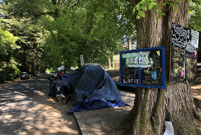 The view from SE Oak and 37th of tents lining a block adjacent to Laurelhurst Park.