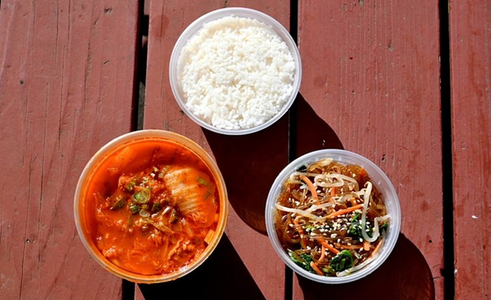 Kimchi soup with a side of japchae and rice