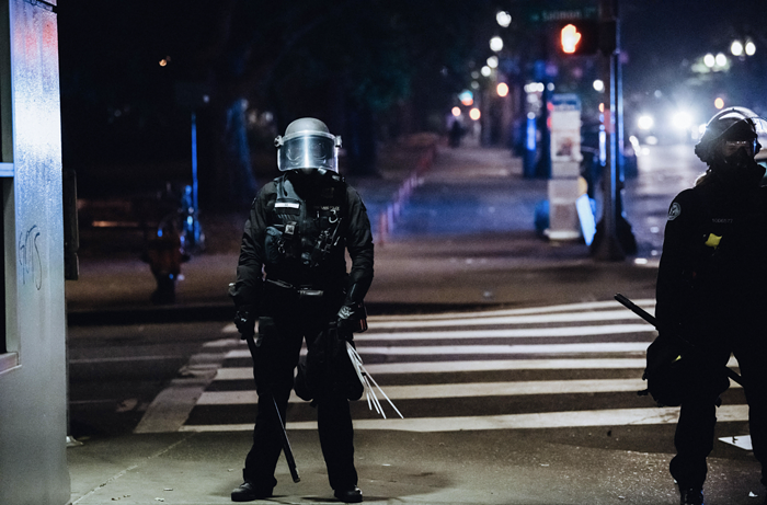 A Portland police officer stands during a July 2020 racial justice protest.