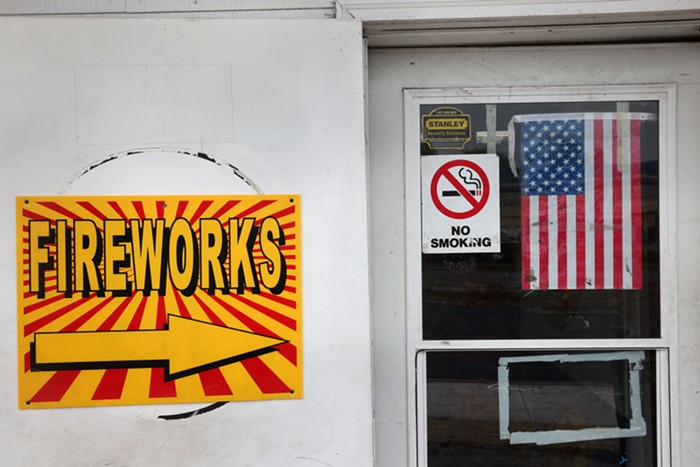 A store with a sign advertising fireworks