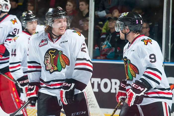 Winterhawks players in 2014, wearing jerseys emblazoned with the teams now-retired, racist logo.