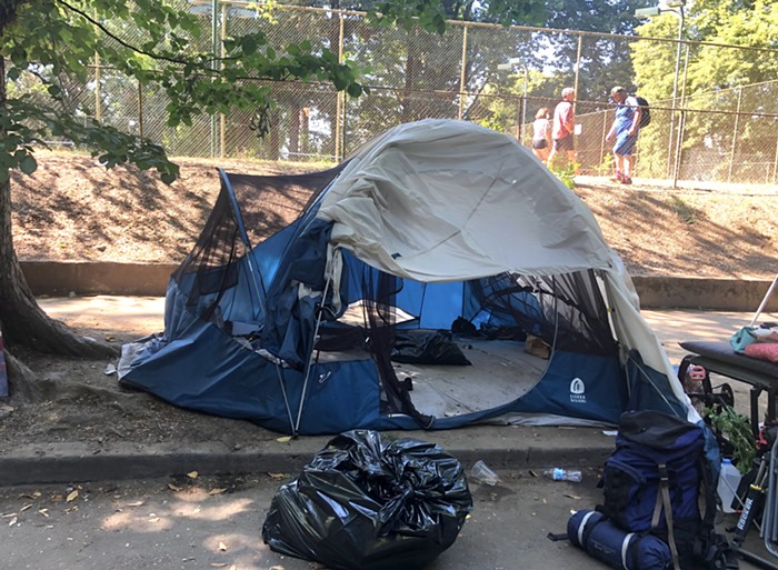 A tent sits empty Thursday morning, after its tenants packed up their belongings to relocate.