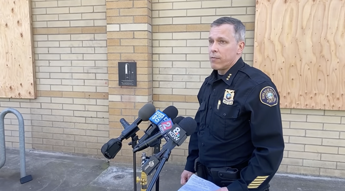 Deputy Chief Chris Davis speaking at a press conference in April 2021.