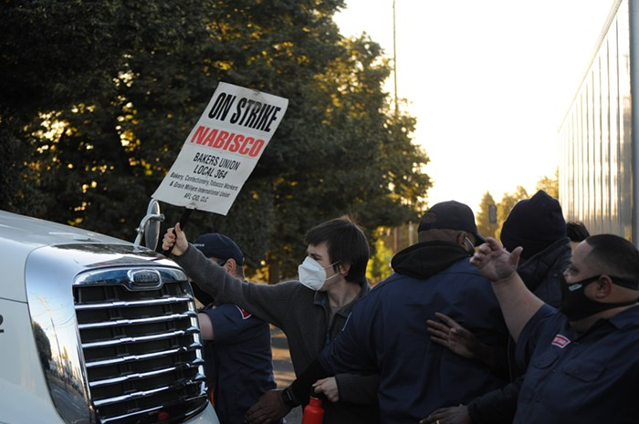 Supporters of the Nabisco workers strike in Northeast Portland attempt to block truck traffic last week.