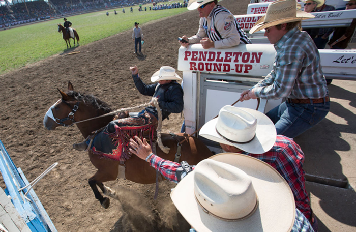 Let er buck? COVID-19 spike at Pendleton Round-Up causes public health emergency.