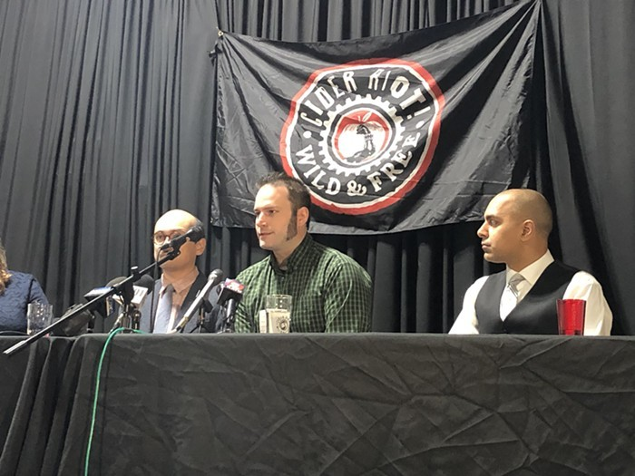 Cider Riot owner Abe Goldman-Armstrong speaks at a press conference announcing his lawsuit against Patriot Prayer.