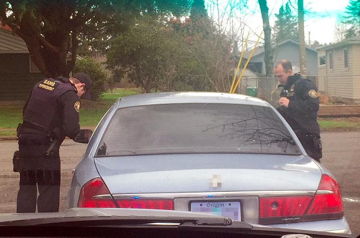 A photo from 2017 show Portland police officers with a now-dissolved gun violence team making a traffic stop.
