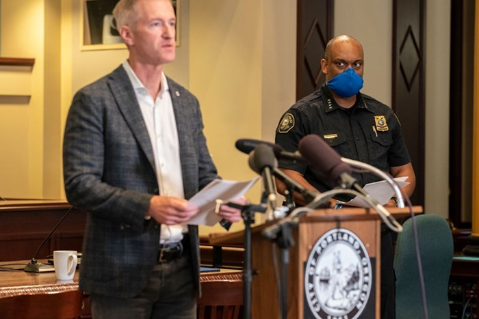 Mayor Ted Wheeler addresses media at a Sunday, Aug. 30 press conference, as Portland Police Chief Chuck Lovell looks on.