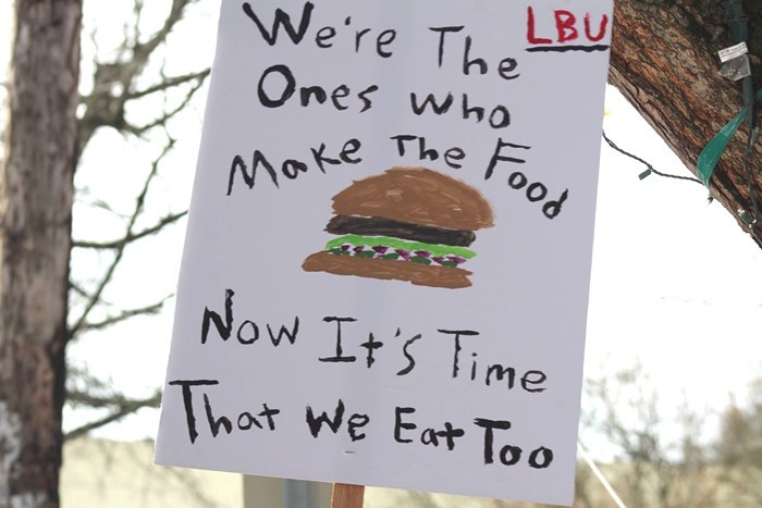A picket sign made by Little Big Burger staff.