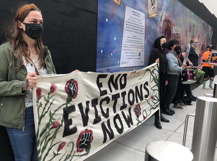 A group of activists protest evictions outside of Multnomah County Courthouse on Tuesday, June 15.