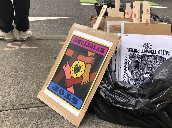 Protest signs at a June 15 eviction protest in downtown Portland.