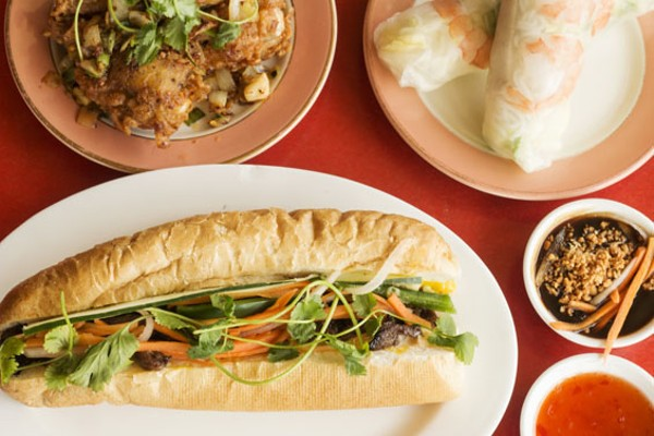 Butter-garlic chicken wings, spring rolls and grilled pork banh mi. - MABEL SUEN