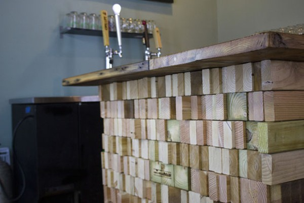 Made with reclaimed wood, the bar was designed by local artisan Mwanzi. - PHOTO BY SARAH FENSKE