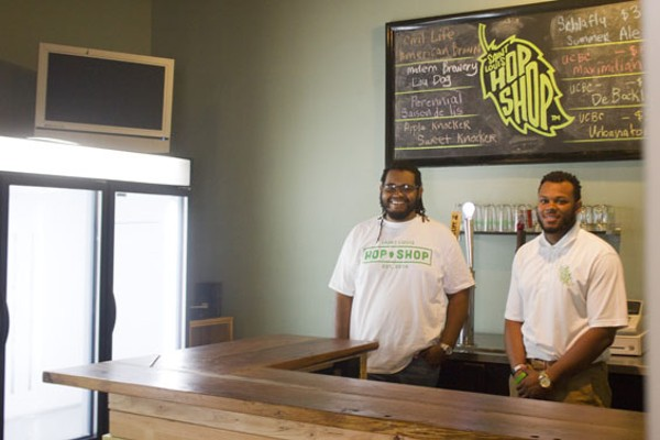 Harris (left) and Griffin work the bar at Saint Louis Hop Shop. - PHOTO BY SARAH FENSKE