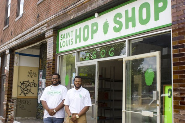 Co-owners Justin Harris and Ryan Grifffin in front of their new Cherokee beer shop. - PHOTO BY SARAH FENSKE