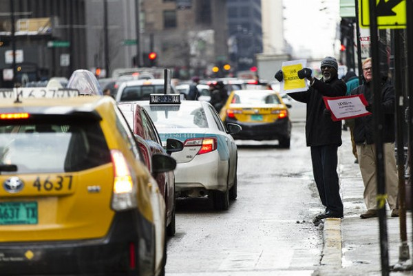 Taxi drivers in Chicago protest Uber. - PHOTO COURTESY OF FLICKR/SCOTT L