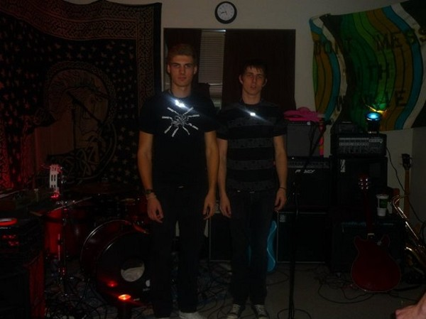 The members of Volcanoes in their Lindenwood University dorm room. - BRITTANY ESTES