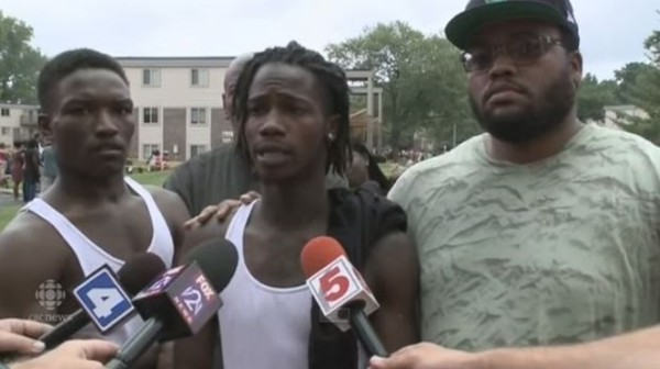 Dorian Johnson (center) talks to the media just after Michael Brown's shooting. - IMAGE VIA YOUTUBE