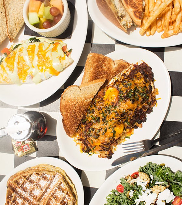 "An array of Kingside's food, including a spinach omelet, grilled chicken Cuban sandwich, the ""Kingside Slider,"" waffled French toast and kale salad. - MABEL SUEN"