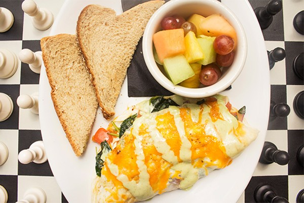 Spinach, tomato, cheddar and red onion omelet with fruit and toast. - MABEL SUEN