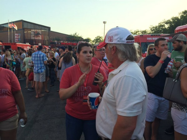 A Bud & Burgers worker explains to an attendee why he cannot be admitted into the burger food truck area. He was thoroughly pissed. - EMILY MCCARTER