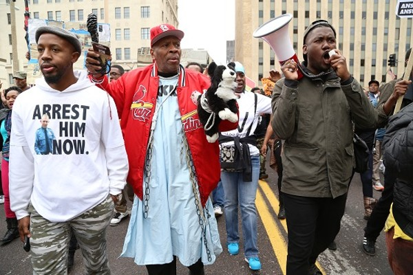 Rapper/activist Tef Poe, right, helps lead protesters on a March through downtown St. Louis. - CHRISTOPHER HAZOU