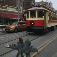 Dinosaur Lurches to Life in the Delmar Loop, Confronts Stegosaurus