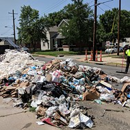 Smoldering Garbage Truck Dumps Hot Load of Trash On St. Louis Street