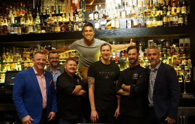 The Gamlin Restaurant Group team with Late Nite Eats host Jordan Andino. From left, Derek Gamlin, Lucas Gamlin, Dustin Parres, Jordan Andino, Ryan Cooper, Carl Hazel and Jeremy Beatty. - PHOTO COURTESY OF GAMLIN WHISKEY HOUSE.