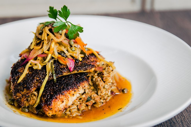 Cast-iron blackened redfish with dirty rice and sauce meunière - COURTESY OF 1764 PUBLIC HOUSE