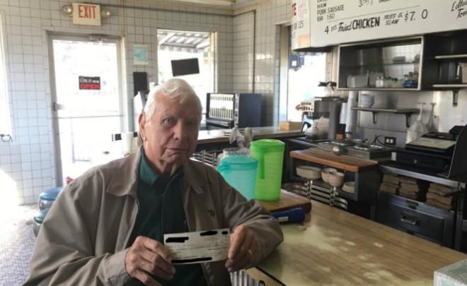 Eat Rite owner LB Powers holds a check with the money raised via GoFundMe. - PHOTO COURTESY OF BJ KRAIBERG.