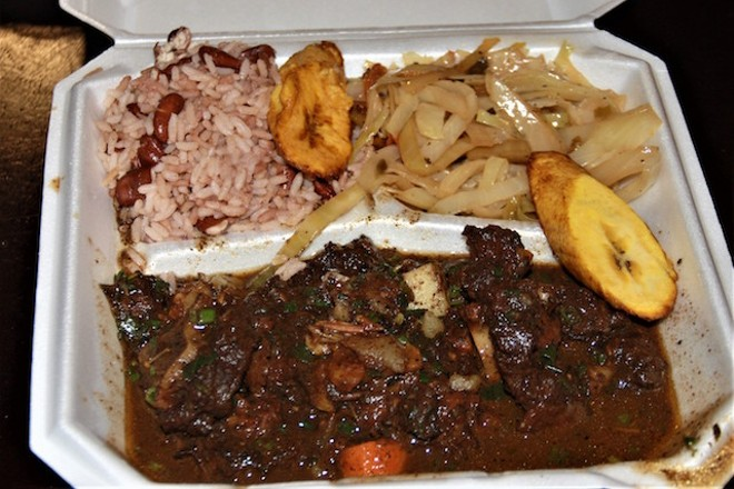 Ox tails are served with beans and rice and plaintains. - PHOTO BY JESSY KINZEL