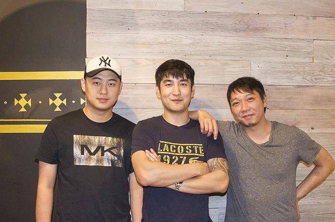 Co-owners Yijun Chen (center) and Yong Liu (right) with Bing Bing Manager Xun Lee. - MABEL SUEN